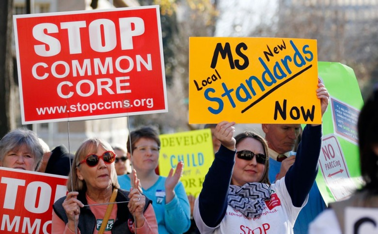 Common Core opponents wave signs and cheer at a rally opposing Mississippi's continued use of the academic standards in Jackson, Miss. (AP Photo/Rogelio V. Solis,File)