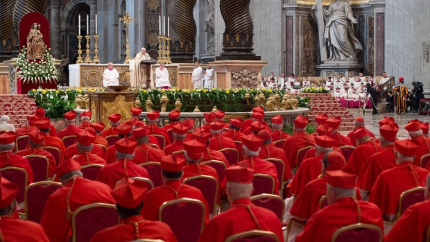 Cardinals listen to Pope Francis as he celebrates a Mass in St. Peter's Basilica at the Vatican in February. Francis welcomed 20 new cardinals. (L'Osservatore Romano/ Associated Press)
