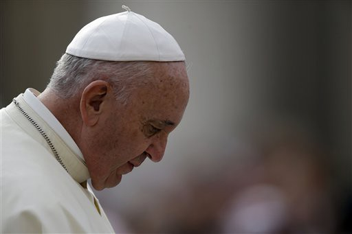 Pope Francis arrives for the weekly general audience in St. Peter's Square at the Vatican, Wednesday, Sept. 16, 2015. (AP Photo/Gregorio Borgia)