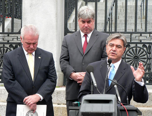 State Rep. Michael Brady (D-Brockton), center, is flanked by colleague Antonio Cabral (right) and Brockton Mayor James Harrington in this 2009 photo of their State House appeal for economic development funding. (State House News Service photo)