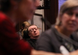 Christine Poff, right and Dr. Joan Berzoff, left, of the National Association of Social Workers testify as an audience member, center, listens. (Evan Lips - New Boston Post)