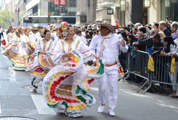New York City's Hispanic Day Parade celebrates Columbus Day as Dia de la Raza (a day to celebrate the Latino culture born form Spanish colonization of the new world.) Photo via Getty Images.