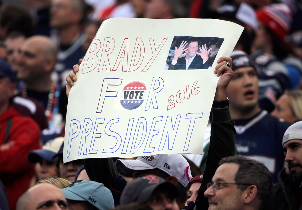 A New England Patriots fan holds a sign that supports Patriots quarterback Tom Brady for president during an NFL football game against the New York Jets in Foxborough, Mass. (AP Photo/Steven Senne, File)