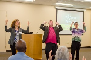 From left to right, Marjie Sokoll, Gary Glazner and Susan McFadden, help show the choreographed movements to a poem. (Beth Treffeisen, NewBostonPost)
