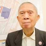 Henry Yee, the co-chairman of the Chinatown Resident Association, a community group, stands in front of a Chinatown map. (Beth Treffeisen)