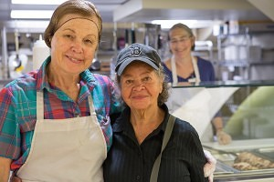 Two volunteers at The Women's Lunch Place (Photo courtesy of The Women's Lunch Place)