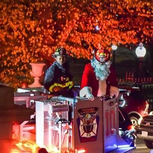Carols ring across Beacon Hill as Christmas tree lights shine