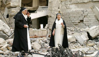 Dominican sisters at destroyed church in Iraq. (Courtesy, Order of Preachers)