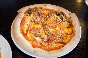 """""""Just the vegan-ning"""" pizza (NewBostonPost, photo by Beth Treffeisen)"""