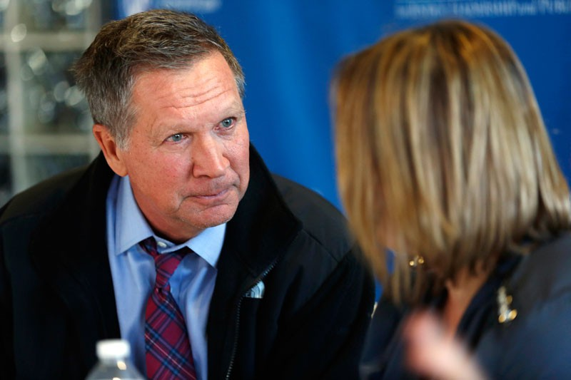 Republican presidential candidate, Ohio Gov. John Kasich listens to Jasmine Marino during a New Hampshire Coalition Against Domestic and Sexual Abuse roundtable meeting Wednesday, Jan. 6, 2016, in Concord, N.H. (AP Photo/Jim Cole)