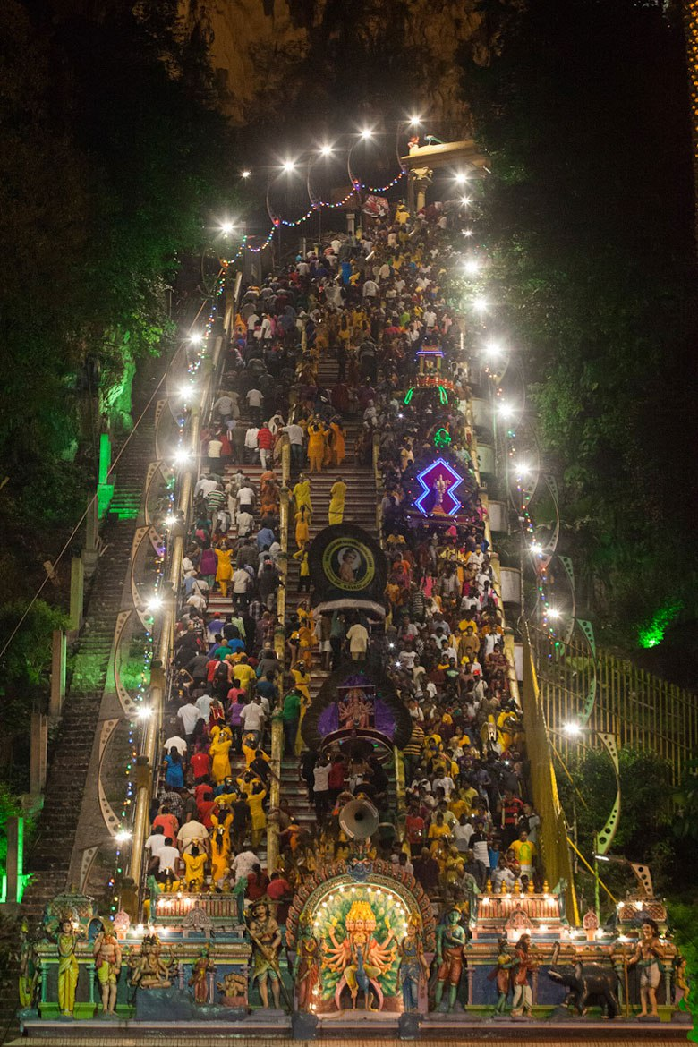 Hindu devotees climb the stairs leading to Lord Murugan's shrine in Batu Caves to give offerings during the yearly Thaipusam Hindu festival. (Religion News Service photo by Alexandra Radu)