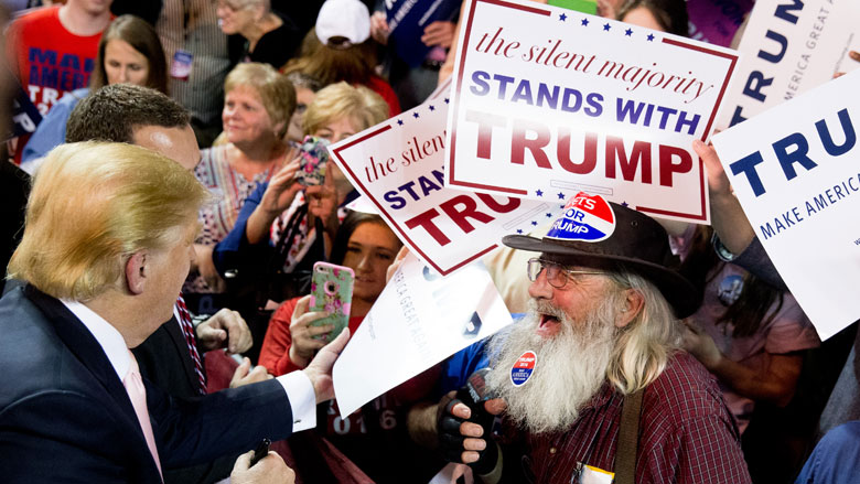 A member of the audience keeps a sticker in his beard as Republican presidential candidate Donald Trump greets members of the audience after speaks at a rally at Valdosta State University in Valdosta Ga. Monday Feb. 29 2016