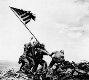 Marines raising the flag atop Mt. Suribachi. (AP photo by Joe Rosenthal)