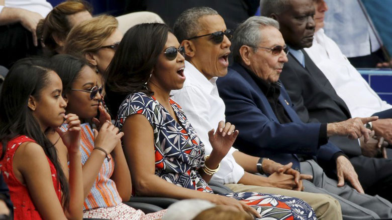 President Obama and his family react along with Cuban President Raul Castro during an exhibition baseball game in Havana. (REUTERS/Jonathan Ernst)
