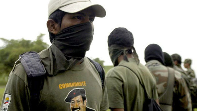 One of seven rebels of the Revolutionary Armed Forces of Colombia, FARC, who surrendered to the Army. (AP photo)