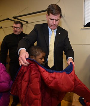 Mayor Martin Walsh joins Richie Paris and other Fire Fighters at the Dorchester YMCA for Operation Warm Coat Drive. (Mayor's Office Photo by Isabel Leon)