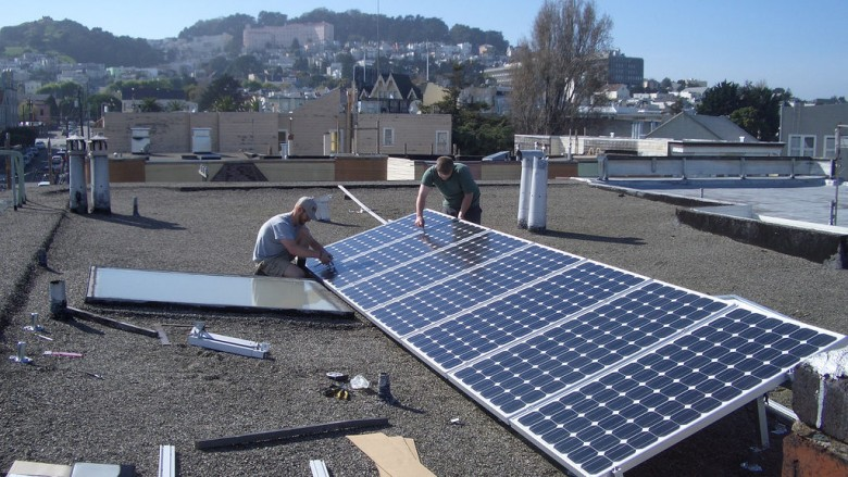 Solar panels being installed on a rooftop. (Photo courtesy of Flickr.com)