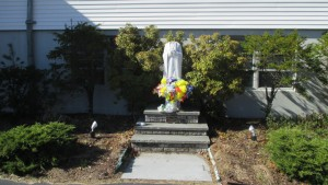 A vandalized statue at St. Mary's Church, Billerica. (Courtesy Billerica Police Department)