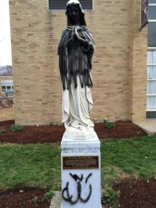 The vandalized statue of the Virgin Mary at the St. Catherine of Siena parish in Norwood. (Courtesy Archdiocese of Boston)