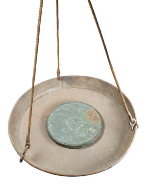 Trade weight for use in balance scales. (Credit: Joseph Bagley, UPNE Press)