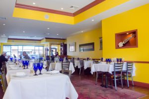 A view of the large dining room at Ariana's Restaurant (New Boston Post photo by Beth Treffeisen)