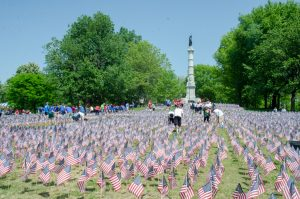 Volunteers continue planting flags on the Boston Common this past Wednesday (New Boston Post photo by Beth Treffeisen)