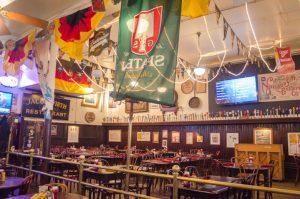 German flags decorate the restaurant (New Boston Post photo by Beth Treffeisen)
