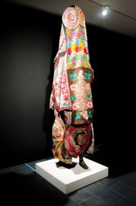 """Soundsuit"" by Nick Cave, a steel armature textile and thread. (New Boston Post photo by Beth Treffeisen)"