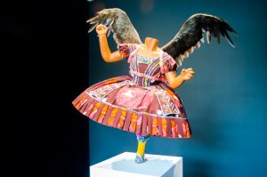 """Food Faerie"" by Yinka Shonibare, mixed media: mannikin, Dutch wax printed cotton, leather, artificial fruit, fiberglass, and goose feathers. (New Boston Post photo by Beth Treffeisen)"