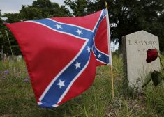 Confederate battle flag flies at the grave of L.S. Axson, a soldier in the Confederate States Army in the U.S. Civil War, in Magnolia Cemetery in Charleston