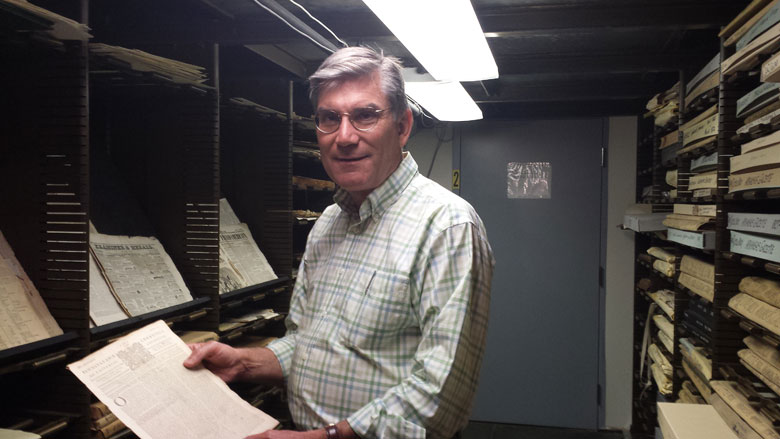 James Moran, Director of Outreach, with colonial newspapers in the AAS archives. (NewBostonPost photo by Mary McCleary)