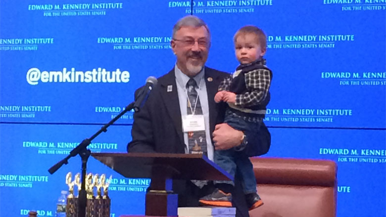 MA Center for Civics Education President Roger Desrosiers (with grandson) at the state finals. (Courtesy, MA Center for Civics Education)
