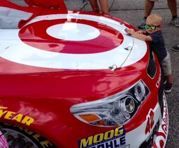 Kyle Larson's son spends some time with daddy's ride. (NBP photo by Diane Kilgore)