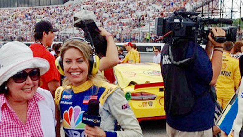 Di mingles with the NBC track crew.