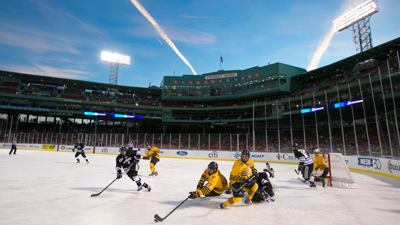 Providence College and Merrimack College play each other in the first period of a game at Frozen Fenway 2014. The game ended in a 1-1 tie. (Photo by Billie Weiss/Boston Red Sox)