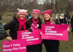 Planned-Parenthood-Rally-Photo-Three-Women-Holding-Pink-Signs-Sunday-3-5-2017
