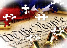 Ammunition and American flag on US Constitution – History of the Second Amendment