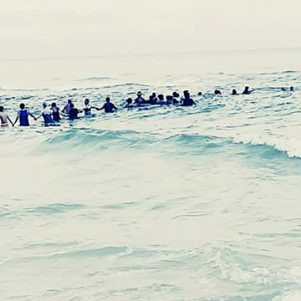 Human Chain Beach Heroes Helped Save A Family; Maybe They Can Help Save A Nation