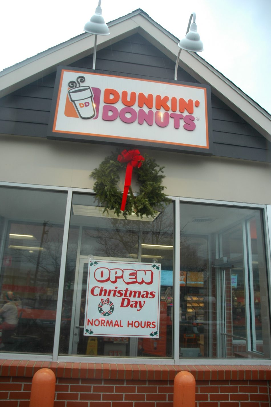 The Dunkin' Donuts at 448 Main Street in Watertown proudly announced it planned to be open all day Christmas. This sign was in the window Friday, ...